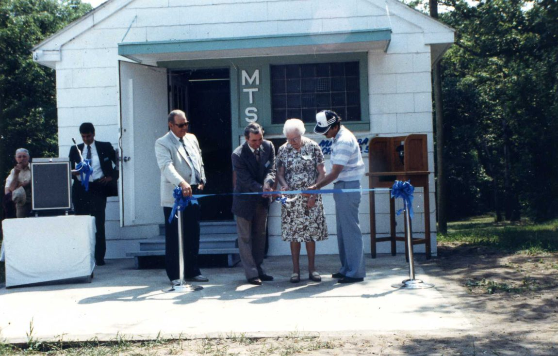 The ribbon cutting: Ed Tinkler (MTS), Rod Demoline (MTS), Effie McClean (MTS), Terry Farley (Museum)